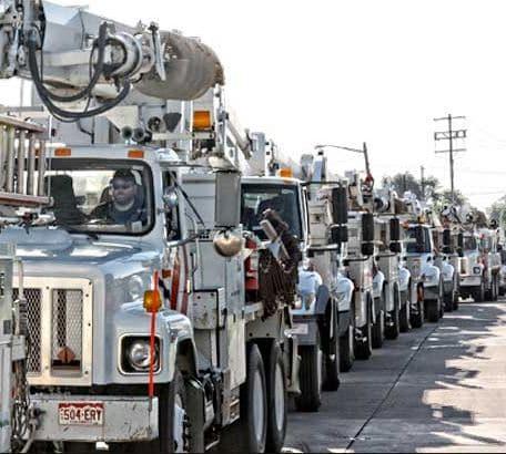 Utility Trucks Repair Hurricane Damage